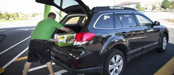 guy loading groceries-Walmart grocery